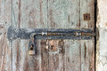 Old latch on a wooden peeling door Royalty Free Stock Photo