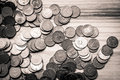 Old Latvian coins on a wooden background - monochrome vintage lo
