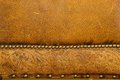 Old leather background detail of antique chair with patterned and brass studs Royalty Free Stock Photos