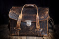 stock image of  Old leather bag on wooden background