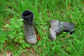 Old leather boots lying in grass Royalty Free Stock Photo