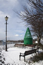 Old leigh buoy lamppost seats under snow leigh sea essex england Stock Photography