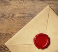 Old letter envelope with wax seal on white Royalty Free Stock Photos