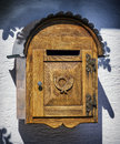 Old letterbox at a wall Stock Photo