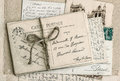 Old letters and antique french postcards vintage sentimental retro style background Stock Image