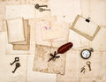 Old letters and photos vintage keys antique clock feather ink pen nostalgic sentimental paper background Stock Images