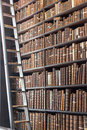 Old Library section with ladder and vintage books Royalty Free Stock Photo
