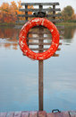 Old lifebuoy near water at autumn Stock Photos