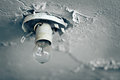 Old light bulb on ceiling of abandoned house Royalty Free Stock Photo