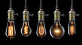 Old light bulbs set of vintage glowing on black Stock Photos