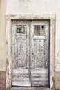 Old light grey double doors with windows Stock Images
