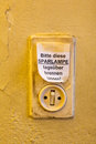 Old light switch with label let it burn saving lamp daytime Royalty Free Stock Image