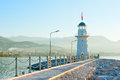 Old lighthouse in alanya on the background of mountains Royalty Free Stock Images