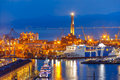 Old Lighthouse in port of Genoa at night, Italy. Royalty Free Stock Photo