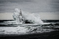 Old lighthouse in the sea in stormy day Royalty Free Stock Photo