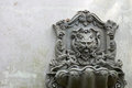 Old Lion Head Fountain, which is mounted on a white-gray wall. Which is not used for a long time Royalty Free Stock Photo