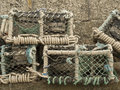 Old lobster pots crab cages weathered and Stock Images