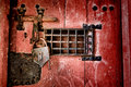 Old lock and locking hardware on antique jail door strong cast iron latch with speakeasy window a medieval dungeon wood Stock Photography