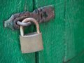 Old lock steel on green and doors Royalty Free Stock Photo