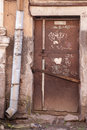 Old locked door in the ramshackle house Royalty Free Stock Photo