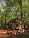 Old log cabin pioneer living in an at callaway gardens Stock Image