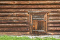 Old log house wood wall with closed door and padlock on it Royalty Free Stock Photo
