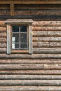Old log house wood wall with window half closed with curtain Royalty Free Stock Photo