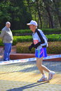 Old long distance runner man running alone on park alleys during st sofia marathon adorable admirable act remarkable fortitude Stock Images