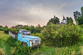 Old lorry in the field under gloomy sky Royalty Free Stock Photo