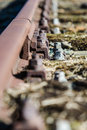 Old and lost Railroadtrack with nut and bolt Royalty Free Stock Photo