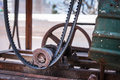 An old machine including reel belt and basket aged by time cover with rust the is in near wreckage state almost Stock Images
