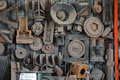 Old machinery parts and tools hanging on farm shed wall Royalty Free Stock Photos