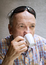Old man drinking cup of coffee Stock Photo