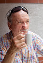 Old man drinking cup of coffee Royalty Free Stock Photos