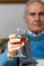 Old man drinking a glass of whiskey Royalty Free Stock Images