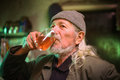 Old man drinking wine Royalty Free Stock Photo