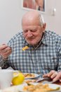 Old man eating a healthy meal Royalty Free Stock Photo