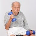 Old man  exercise hold dumbbell Royalty Free Stock Photo