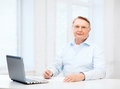 Old man in eyeglasses filling a form at home business tax office school and education concept Royalty Free Stock Photos