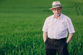 Old man in field Royalty Free Stock Photo