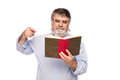 Old man with glasses reading a book Royalty Free Stock Photo