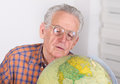Old man with globe Royalty Free Stock Photo