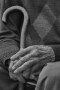 Old man hands monochrome with a stick photo Stock Photos
