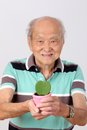 Old man hold pot green leaf heart form Stock Photos