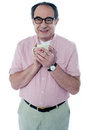 Old man holding a coffee mug Royalty Free Stock Images