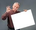 Old man holding empty billboard Stock Photos