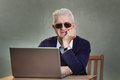 Old man with laptop Royalty Free Stock Photo