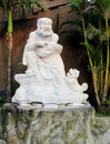 Old man laughing marble statue