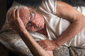 Photo : Old man lying in bed relaxing  cute