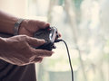 Old man play game console by joystick